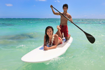 young couple with their paddle board in amelia island